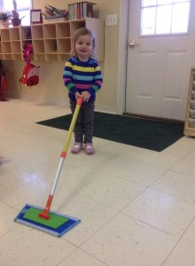 mopping the floor with our child sized mop