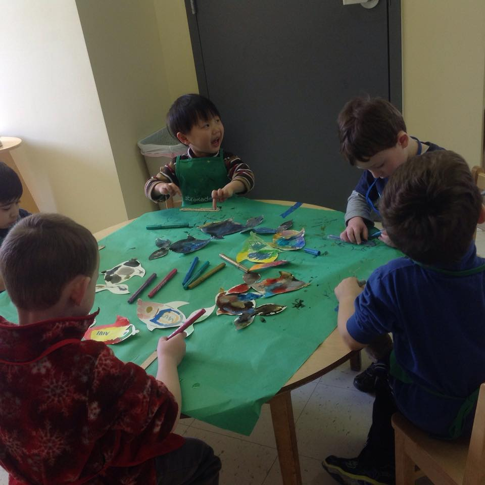 more kids making a rainbow fish