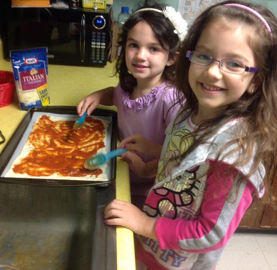 Helping make pizza for snack